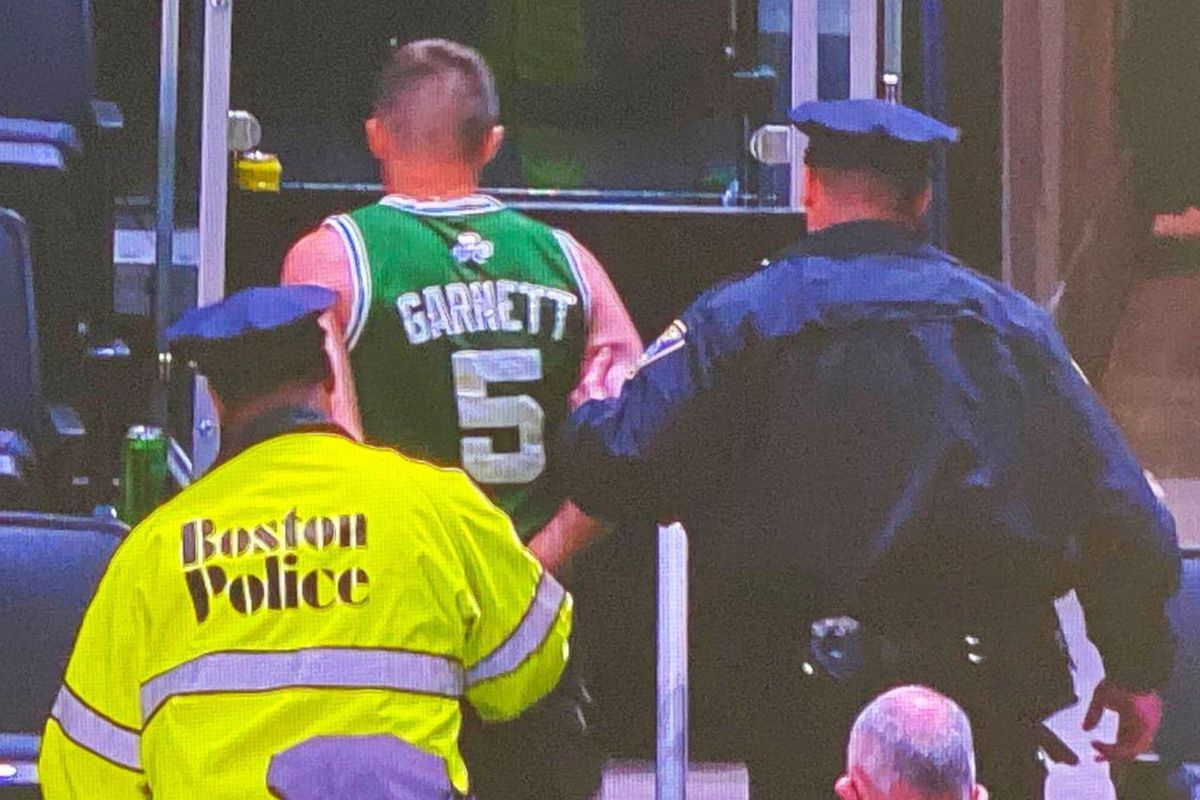fan arrested for throwing water bottle at kyrie